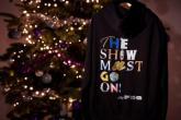 Photo credit: The Show Must Go On Hoodie (Photo courtesy of RAW PR)
