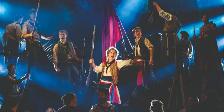 Photo credit:Ashley Gilmour as Enjolras, Harry Apps as Marius and Company in Les Misérables (Photo by Johan Persson)
